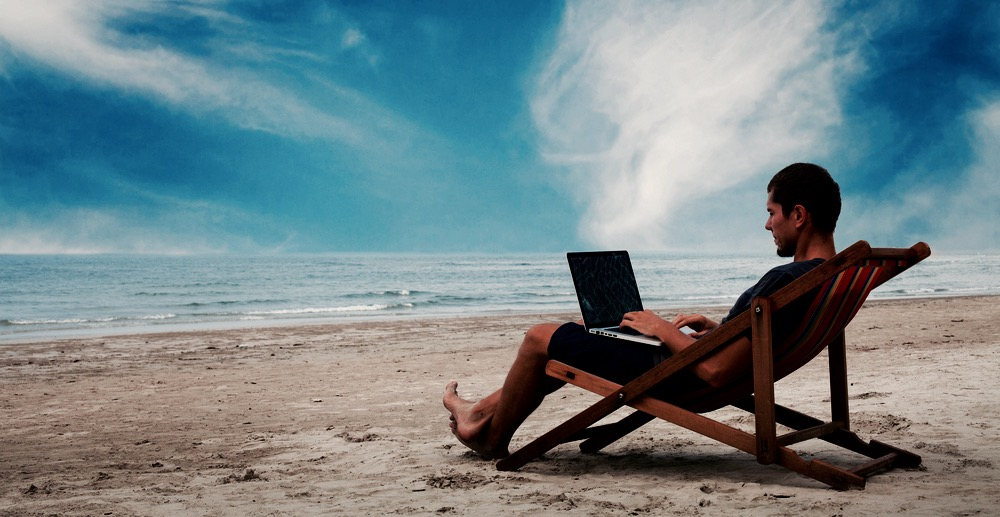 beach computer man
